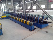 Cold forming machine for upright rack cold formed steel