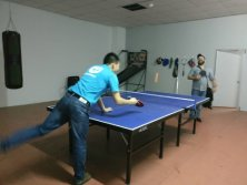 Playing Ping-Pong ball with customer