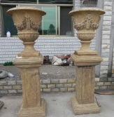 antique stone urn on base