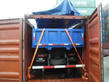 truck with crane shipped by open top container