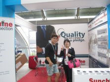 Sales person with CLient in Canton Fair