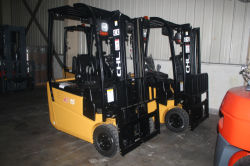 2 units 3 wheel electric forklift in warehouse ready for delivery