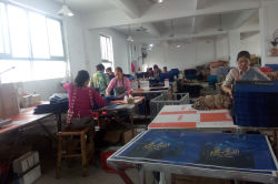 Workers folding paper bags