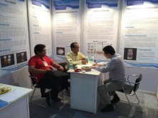 Indian visitors discussing about water decoloring agent