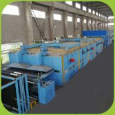 Coating machine for artificial turf