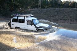 the car with the snorkel crossing water