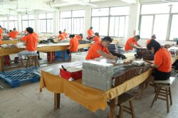 carefully workers are folding the bags - Jialan Package