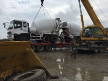 Isuzu Mixer truck loading in our company by Trailer-truck
