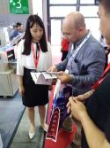A photo with the customer at the Canton Fair...
