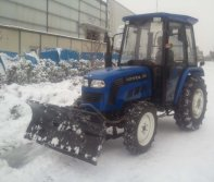 Lovol tractor removing snow on the street of Russia