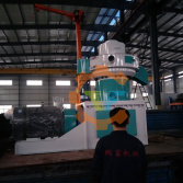 The workers are preparing for the transportation of vertical pellet pelletizer