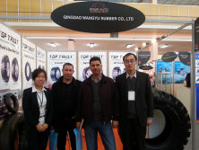 WITH OUR CLIENT AT THE TIRE EXPO AT OUR BOOTH