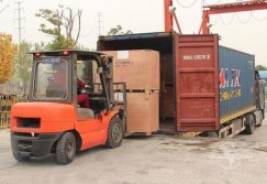 Packing machine container loading