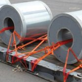 Steel rolls on a flat rack