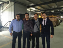 customers visiting factory and checking machine