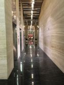 Via Lactea Black Granite Floor & Travertine Noche Wall Hotel Project