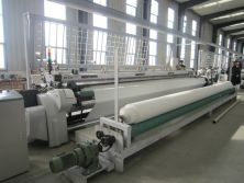 Woven geotextile production machine