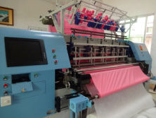 High speed lock stitch quilting machine for comforter quilts
