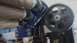 gearwheel and roller- chain stitch quilting machine