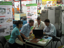 The sales director-Mr.Richard is talking with the customers in the exhibition