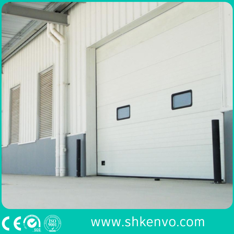 China Automatic Overhead Sectional Garage Door With Small Wicket