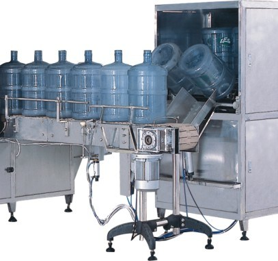 High Quality Bottle Filling Machine with Best Price Xg-100j (60BPH) pictures & photos