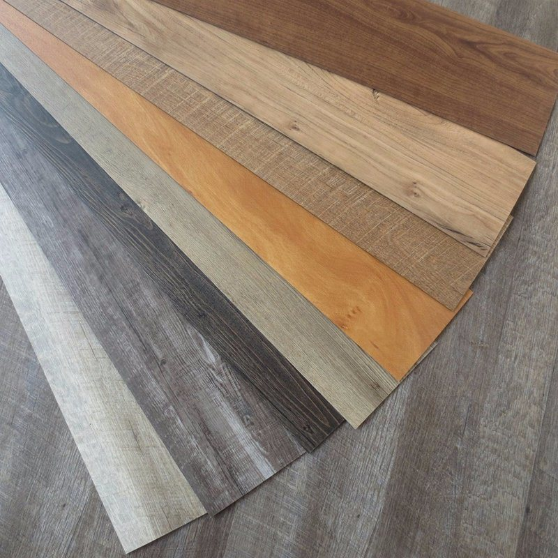 China Wear Proof Poly Vinyl Chloride Wooden Veins Plastic Flooring Wpc