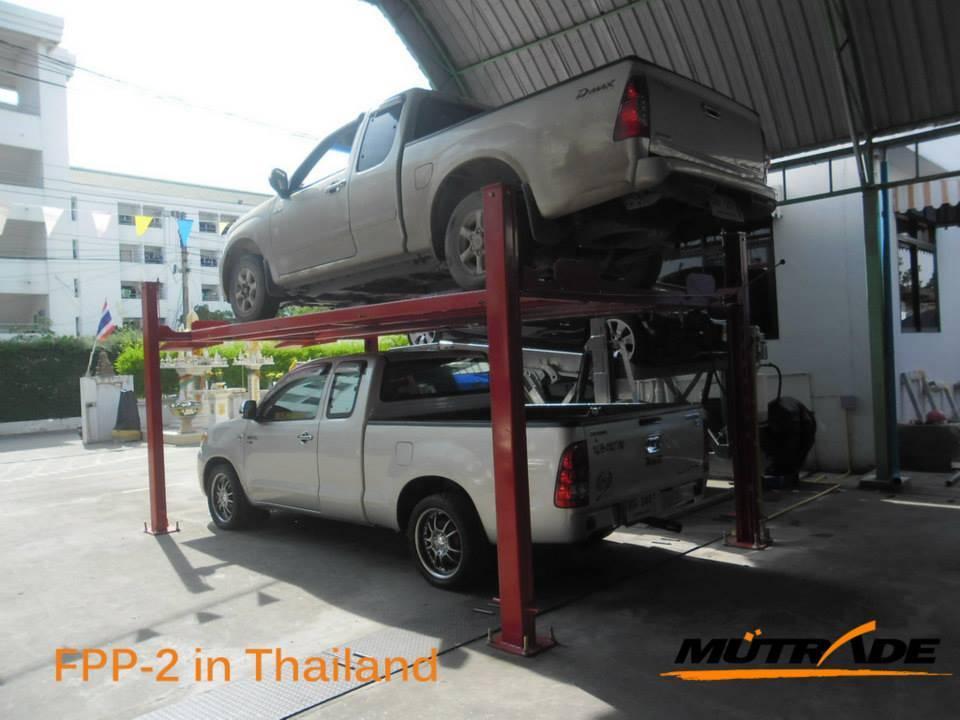 China Two Vehicle Hydraulic Parking Lift 4 Post Car Garage Equipment