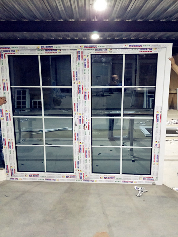 China Top Quality Double Glazed Grill Design Upvc Door For Building