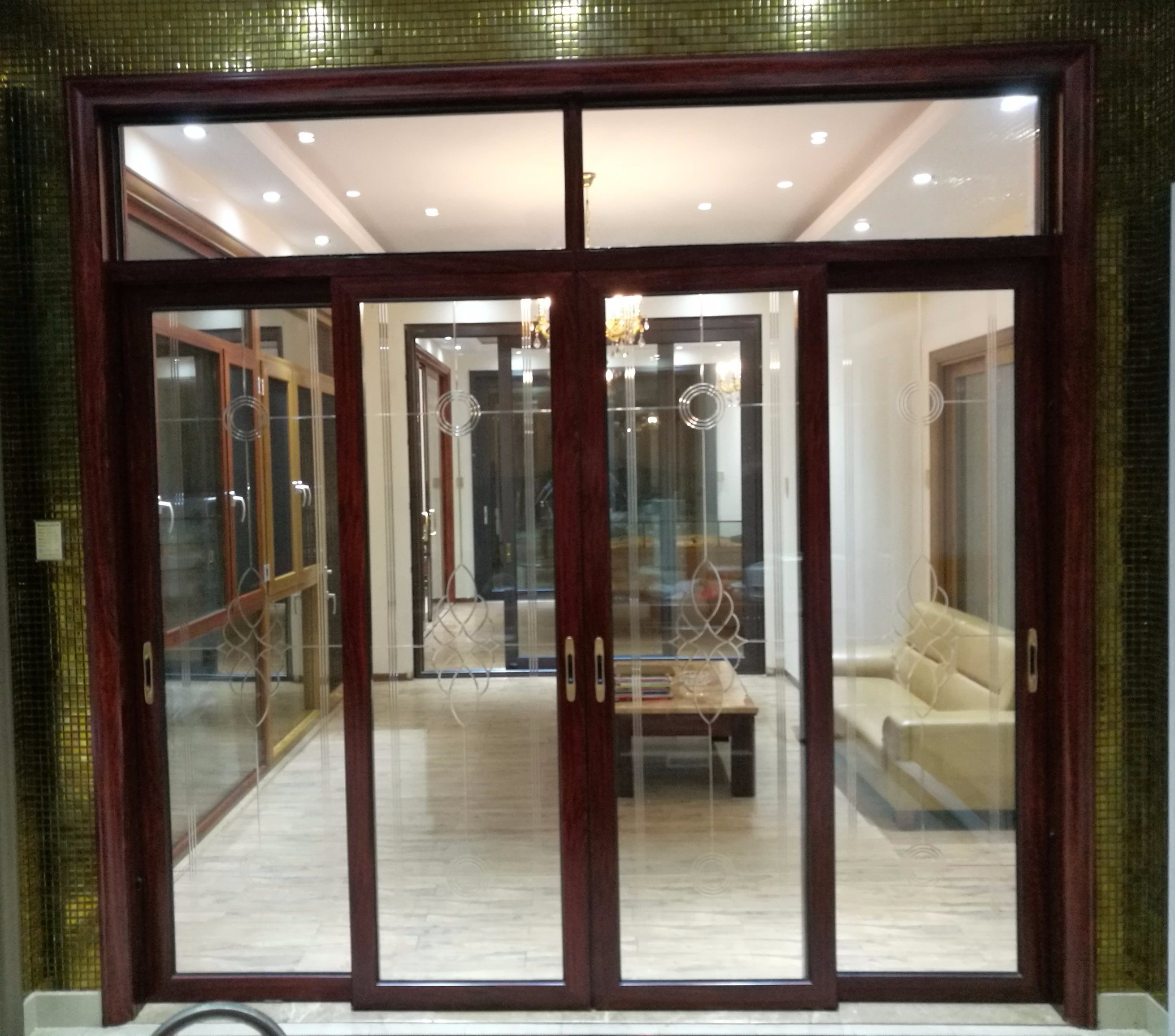 The Parten Aluminum Hanging Door With Art Glass