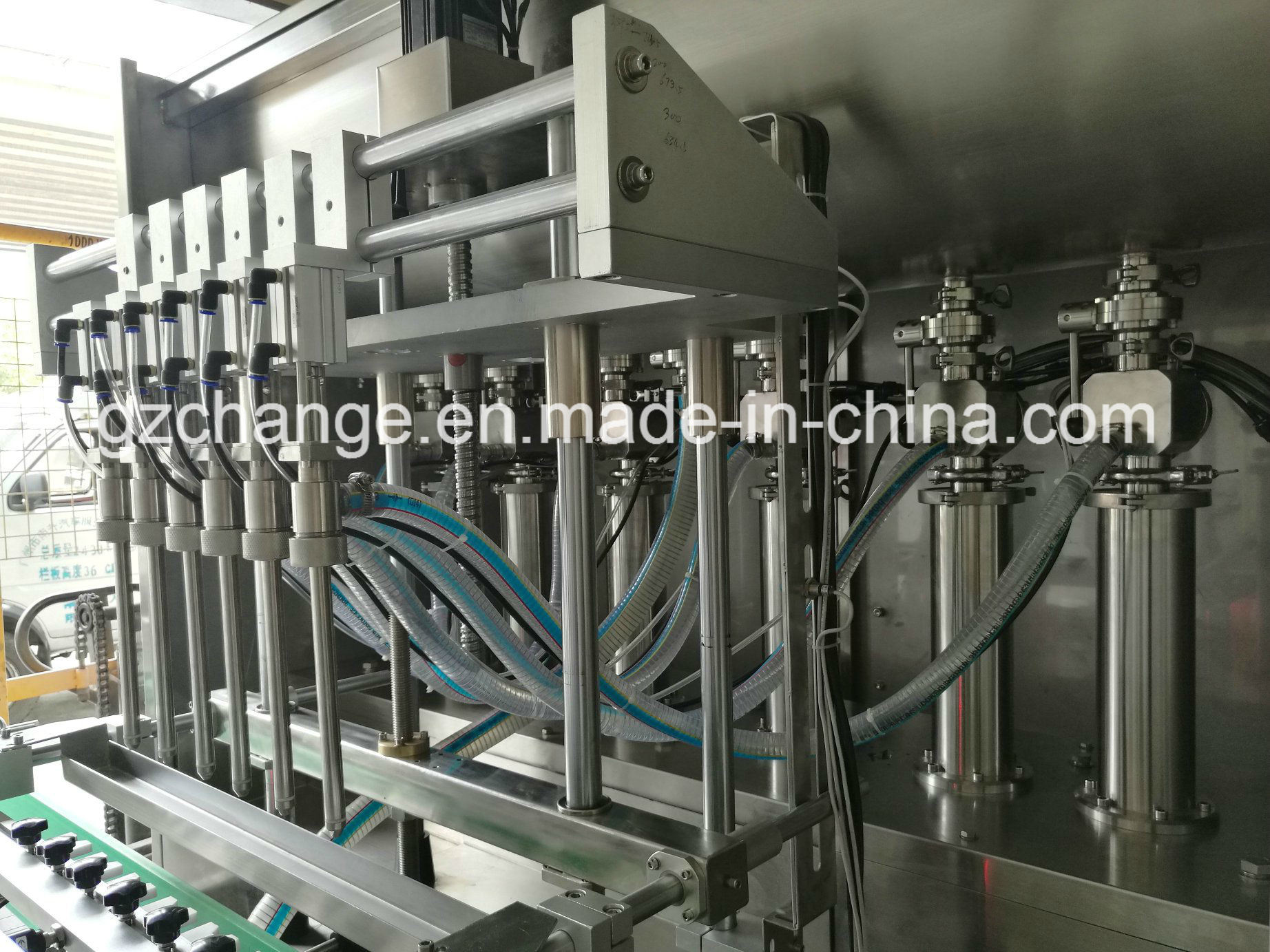 Liquid Paste Products Piston Pump Filling Machine pictures & photos