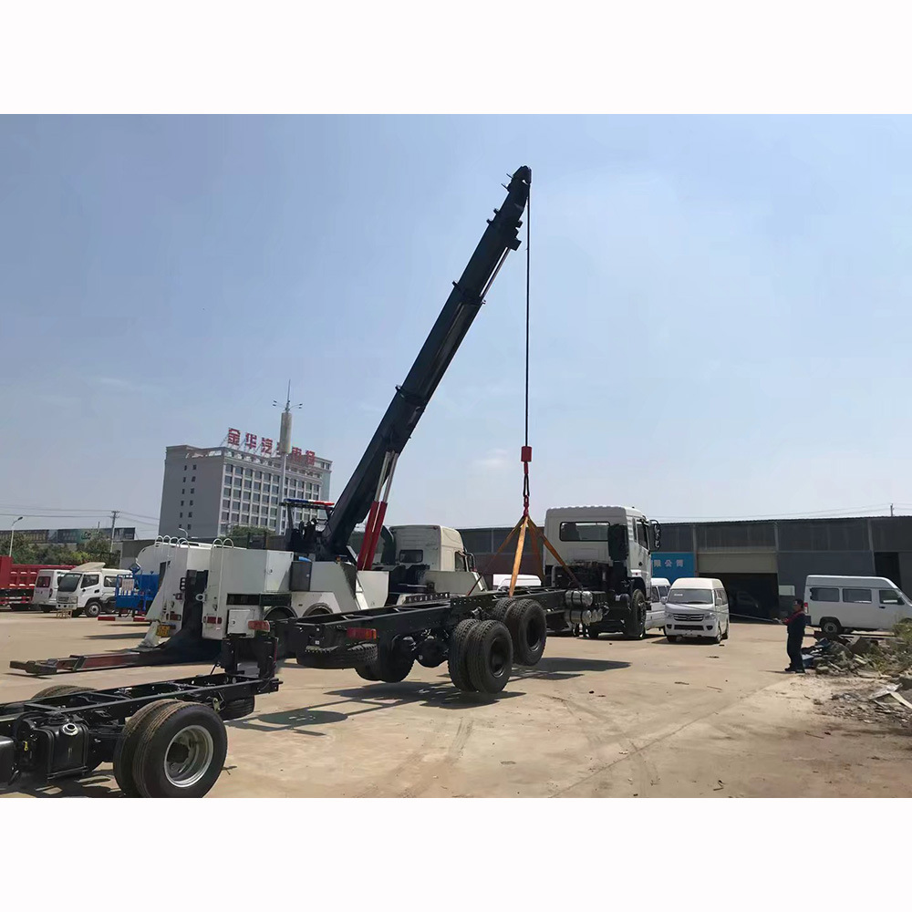 80 Ton Rotator lifting a 50 Ton tow Truck from the side