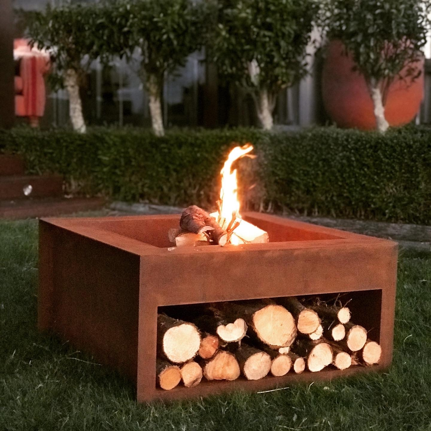 China Free Standing Outdoor Metal Fireplace With Wood Storage China Fire Pit And Corten Steel Fire Bowls Price