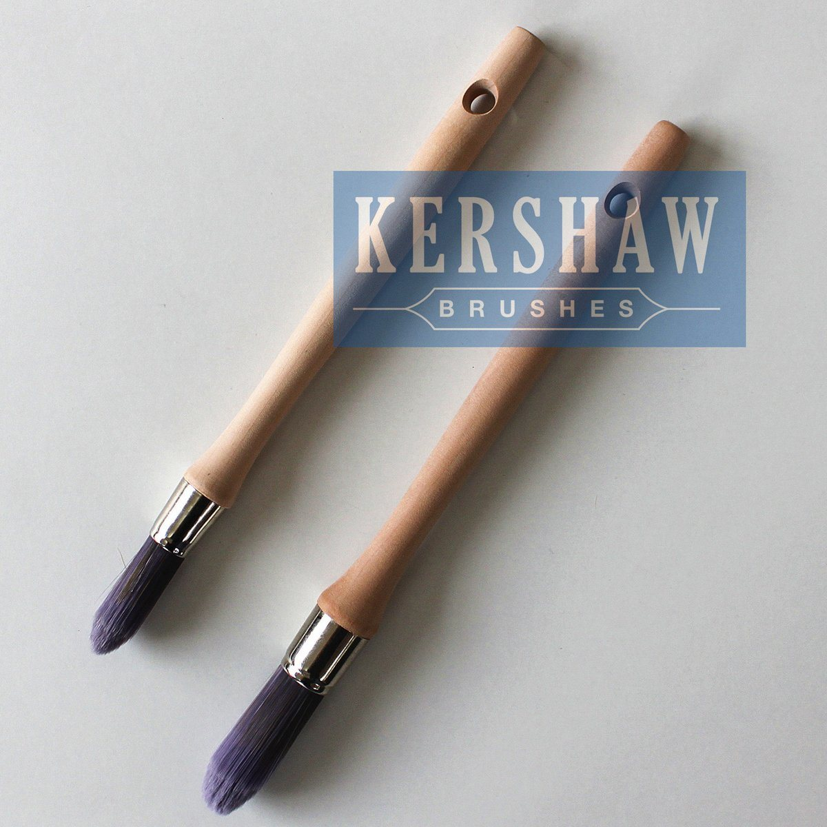 Round Brush (Paintbrush with purple tapered filament and hard wood handle, tip-round brush)