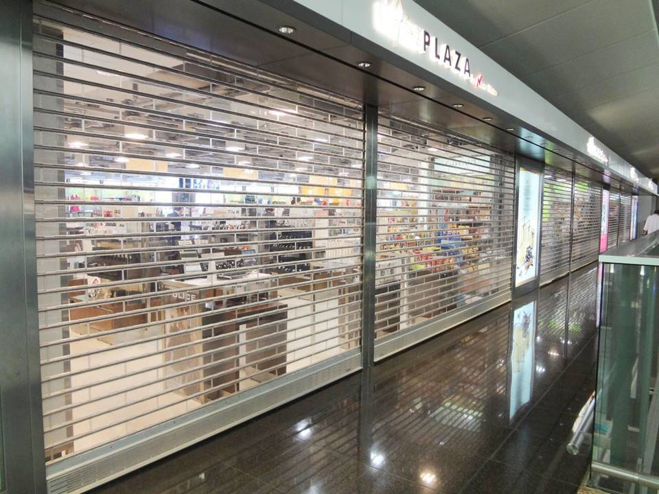 China Aluminum Frame Commercial Manual Glass Pc Crystal Roller Shutter Door Polycarbonate Rolling