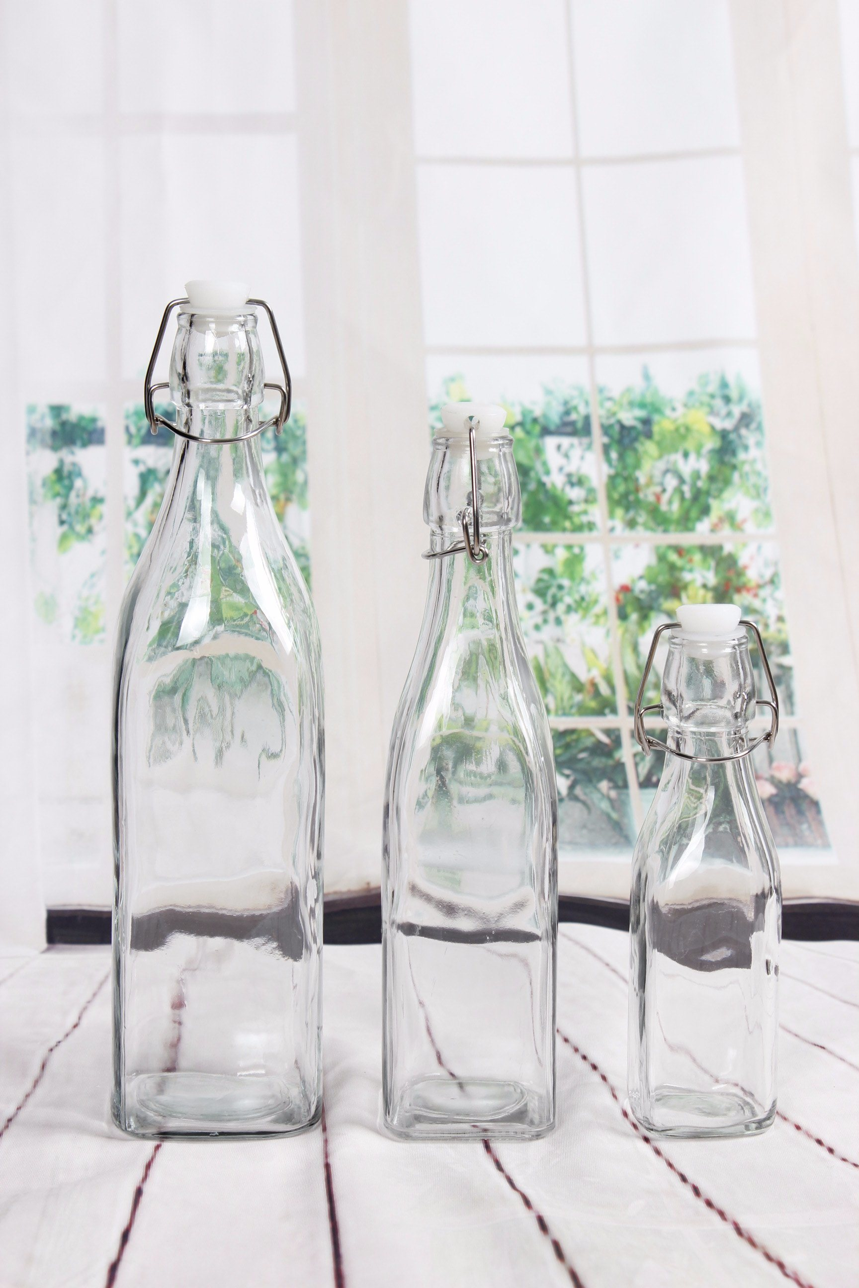 3 Size Square Practical Oil Juice Tea Glass Bottle with Galvanize or Stainless Steel Clip pictures & photos