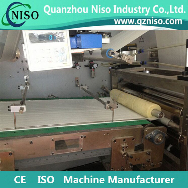 Full Servo Professional Disposable Under Pad Making Machine pictures & photos