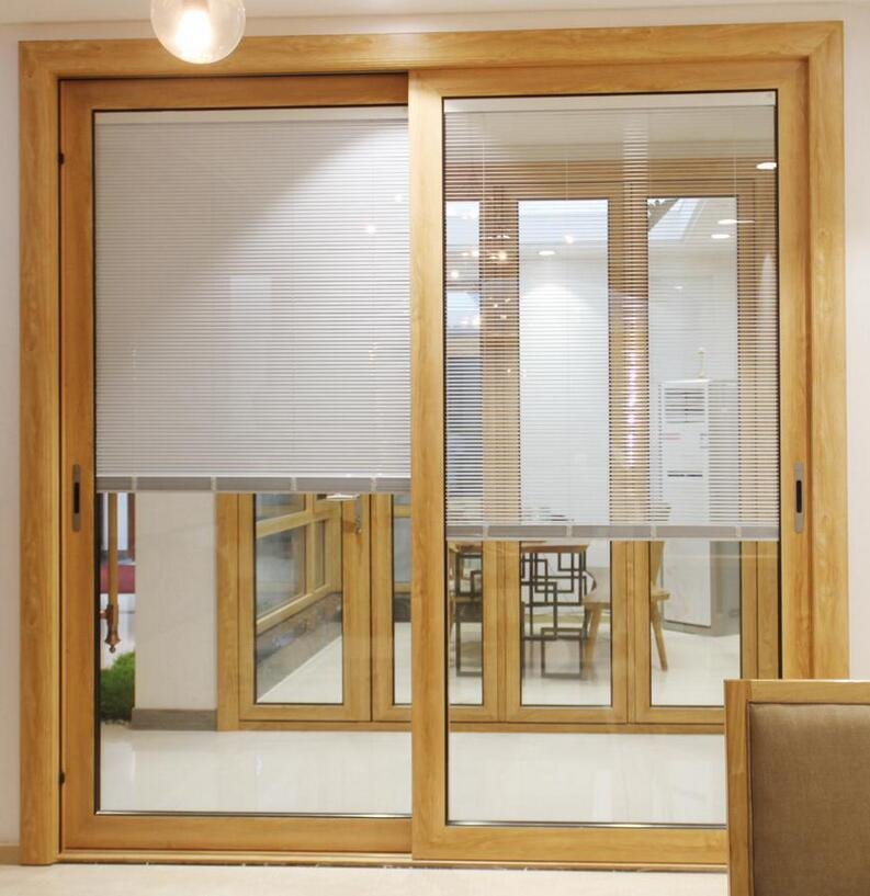 China Wooden Color Film Coated Pvc Sliding Door With Interial Roller
