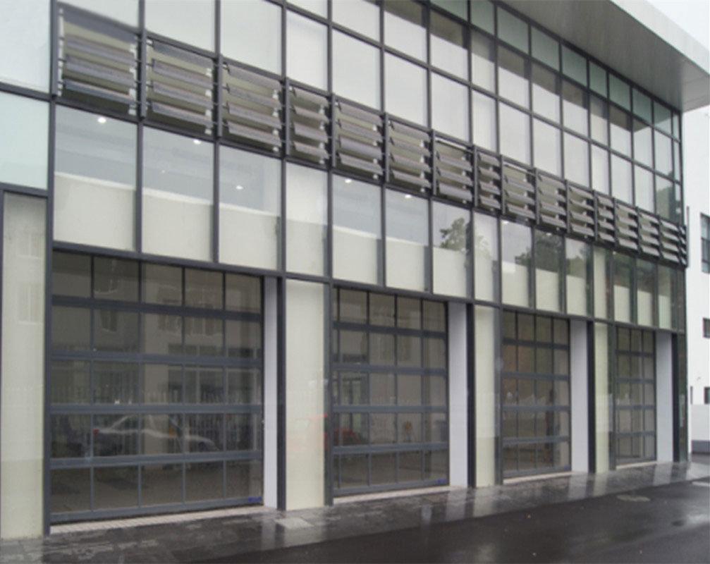 China Electric Pc Aluminum Sectional Glass Door With Pedestrian Door
