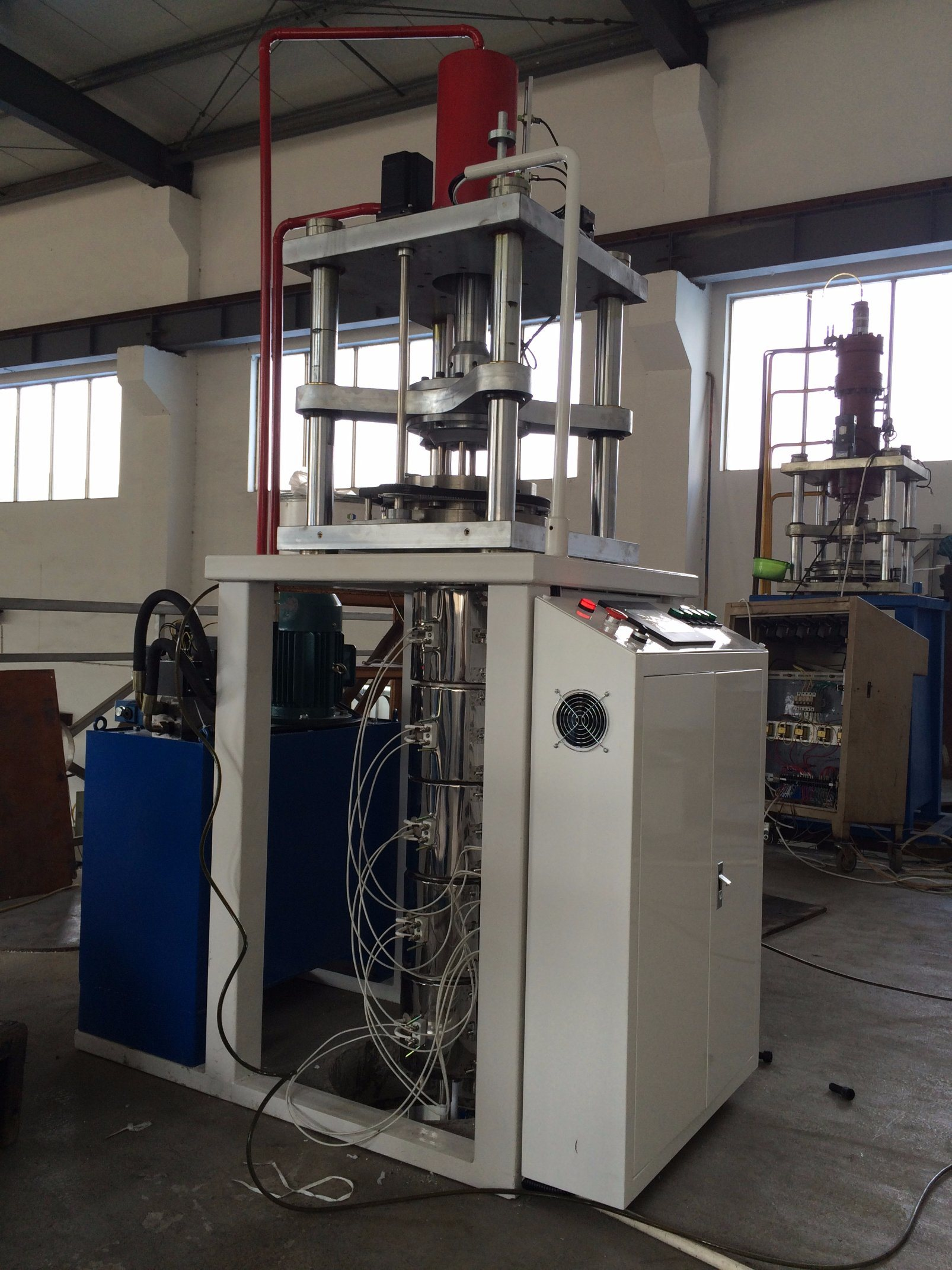 Vertical RAM Extrusion Machine for Teflon Rod
