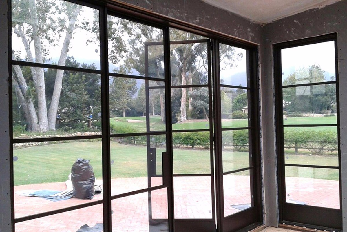 China Wrought Iron Exterior Steel French Bi Fold Door With Glass