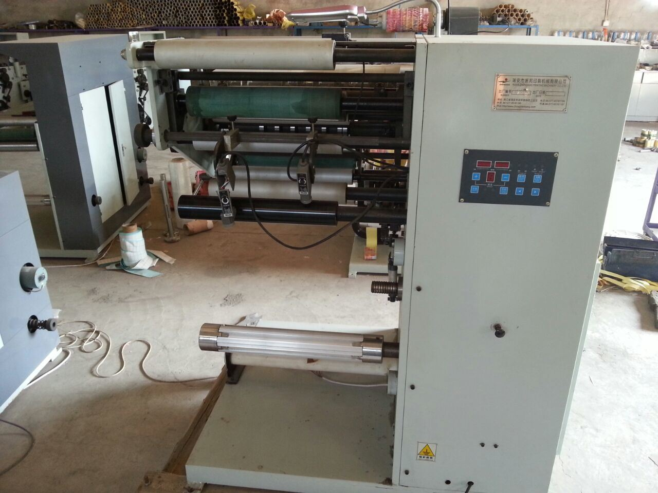 Label Slitting Machine with Two Changeable Shafts pictures & photos