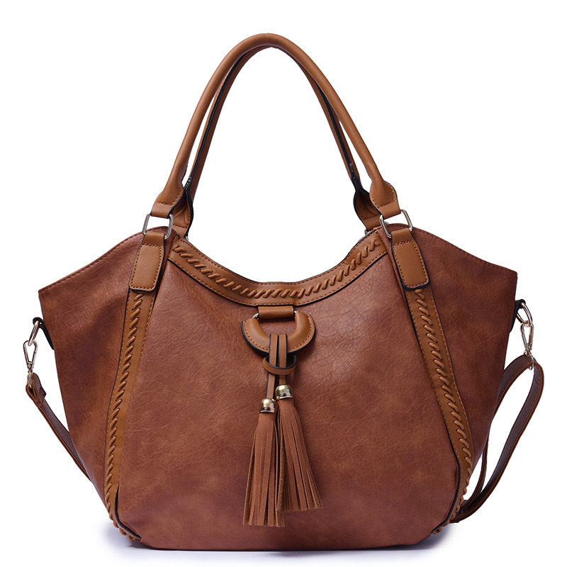 3557ce40db China New Italy Code Braided Shoulder Bag Retro Handbag with Tassels -  China Famous Handbags, Leather Handbags