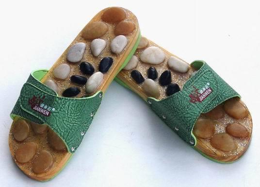 Zapatos de piedra de masaje