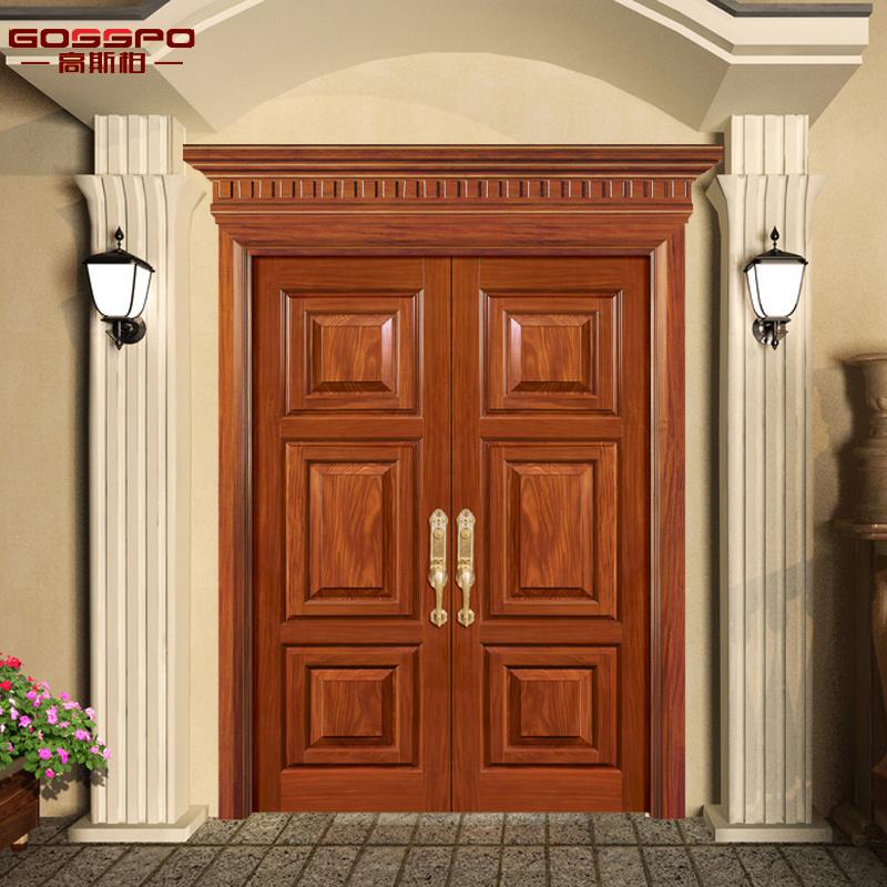 Foto de tallado de la entrada doble de madera antigua for Puertas antiguas dobles