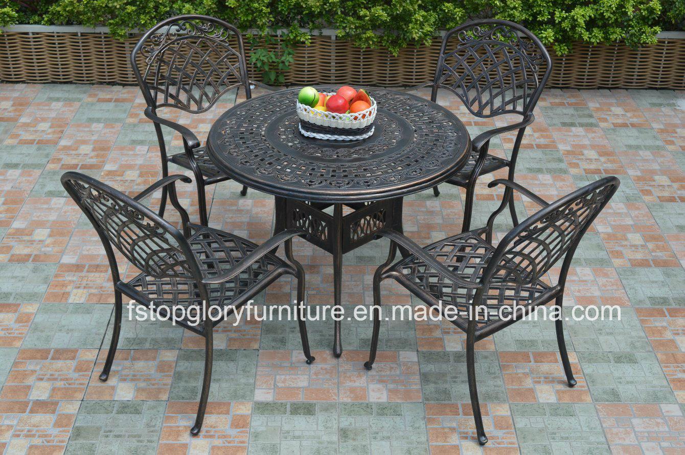 Tableau de thé de fonte d\'aluminium et meubles réglés de jardin de ...