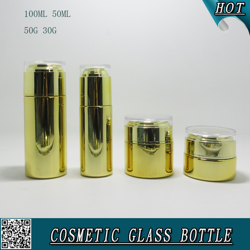 Il colore dell'oro placca le bottiglie di vetro cosmetiche ed i vasi di vetro cosmetici