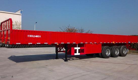 Sinotruk 13.5m Drop Side CargoおよびContainer Semi-Trailer Truck (QDZ950S)