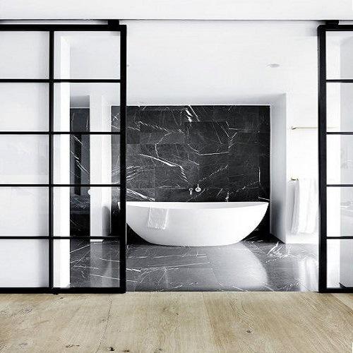 Foto de material de decoraci n nero marquina pisos de for Piso marmol negro
