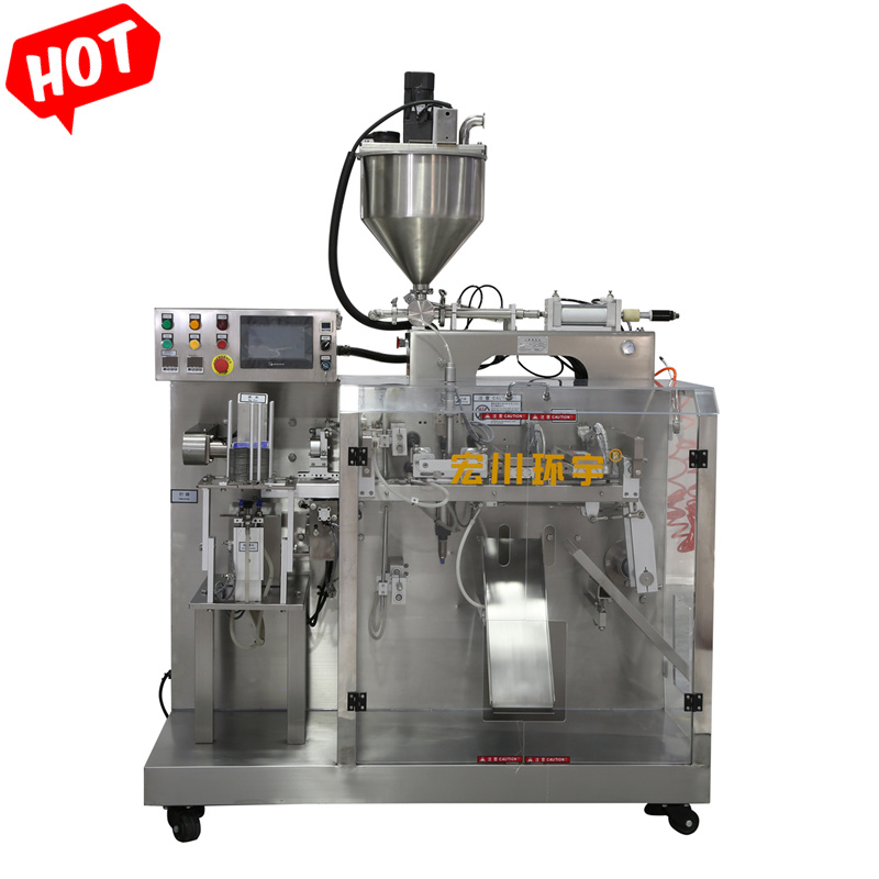 Une laverie automatique Machine d'emballage/ Solution antiseptique Sachet machine de conditionnement de remplissage de liquide